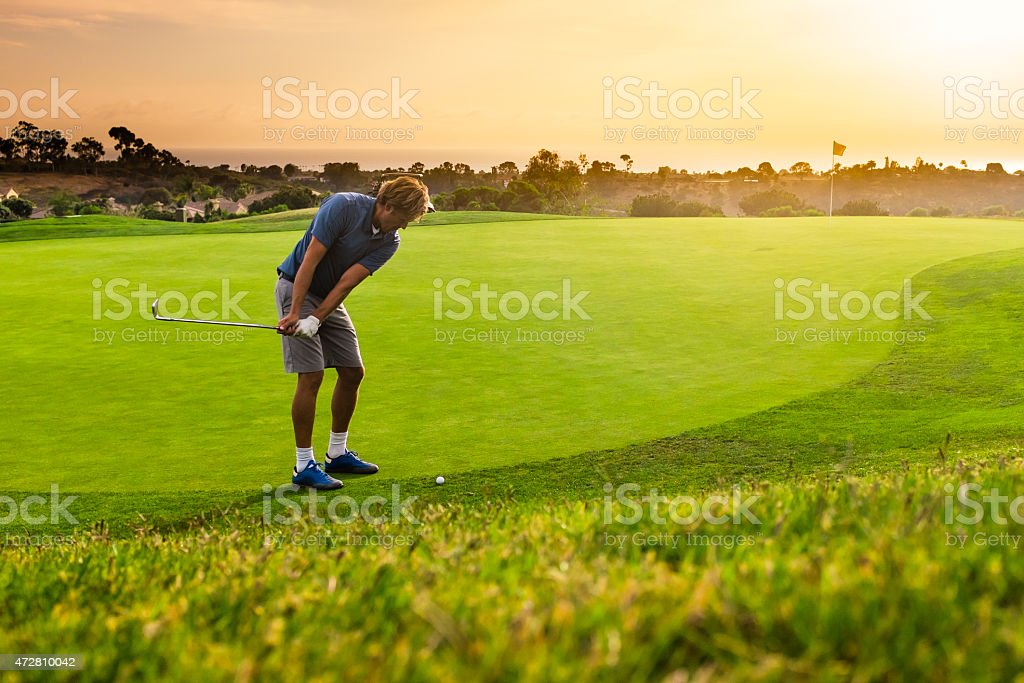 Golfer Chipping stock photo