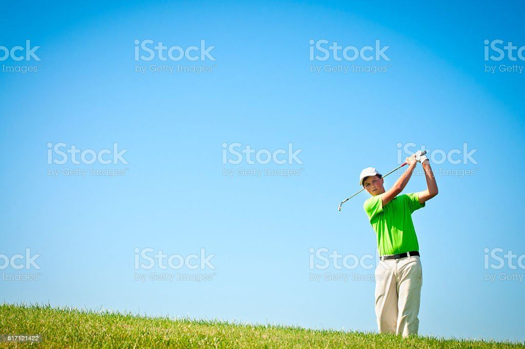 Golfer driving from tee area stock photo