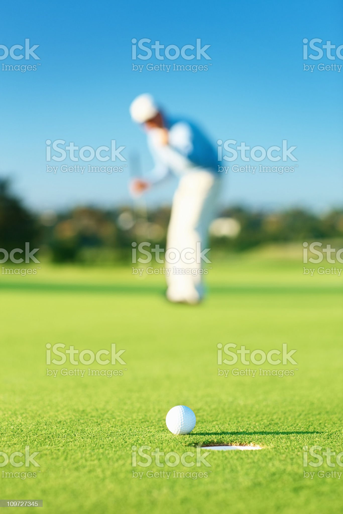 Golfer during a game at the course royalty-free stock photo
