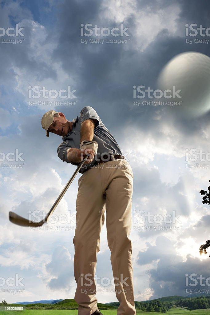 Golfer Hitting Ball stock photo