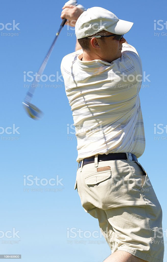 Golfer hitting the ball royalty-free stock photo