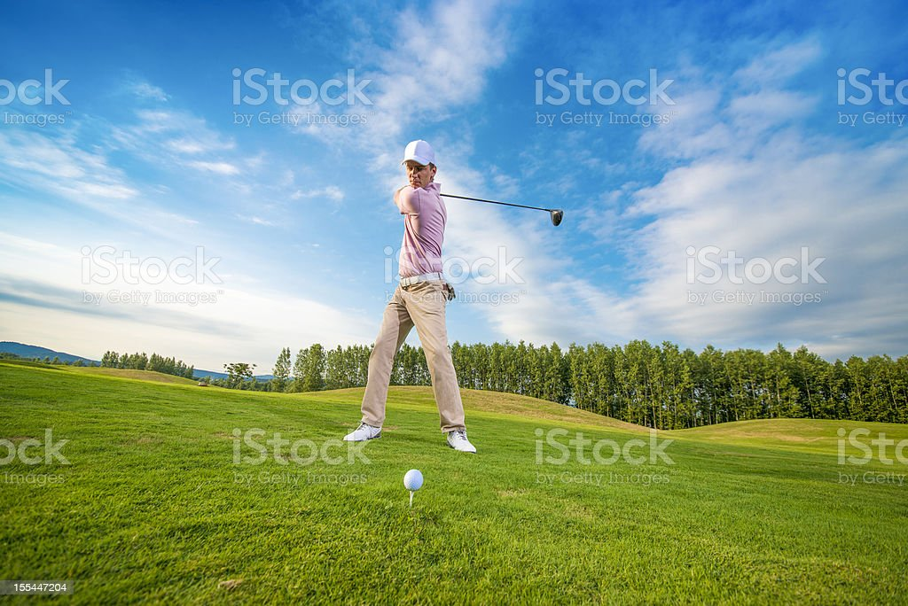 Golfer in backswing with driver royalty-free stock photo
