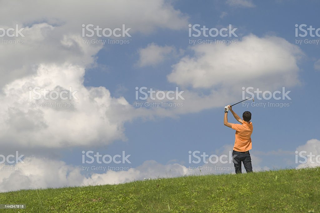 Golfer in orange shirt royalty-free stock photo