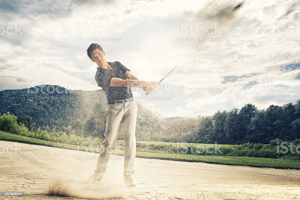 Golfer in sand trap. stock photo