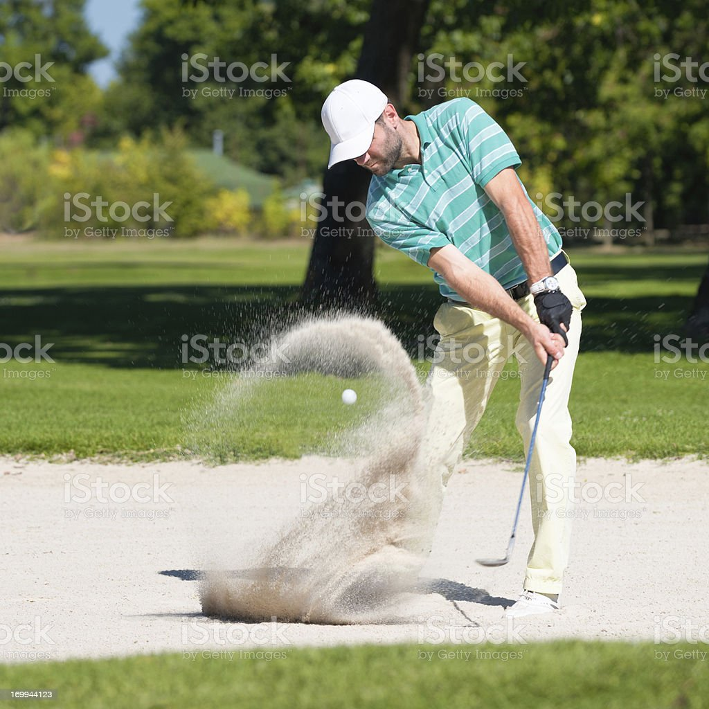 Golfer in sand trap stock photo