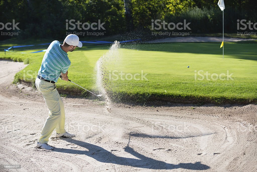 Golfer in sand trap royalty-free stock photo