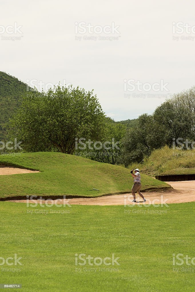 Golfer in the sand bunker royalty-free stock photo