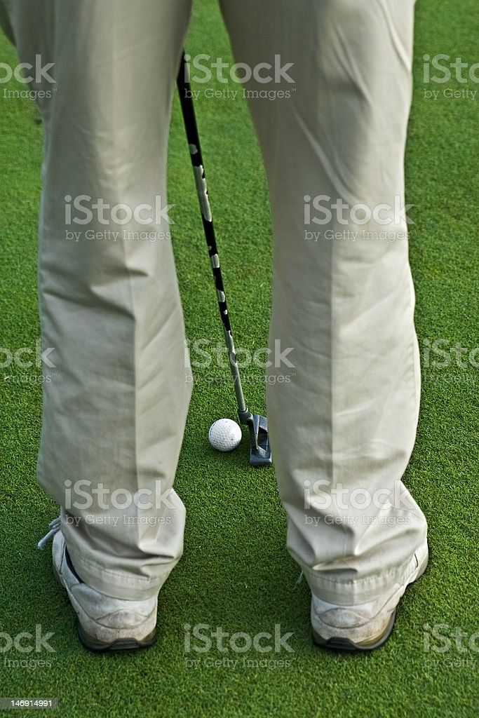 Golfer lines up his put. royalty-free stock photo
