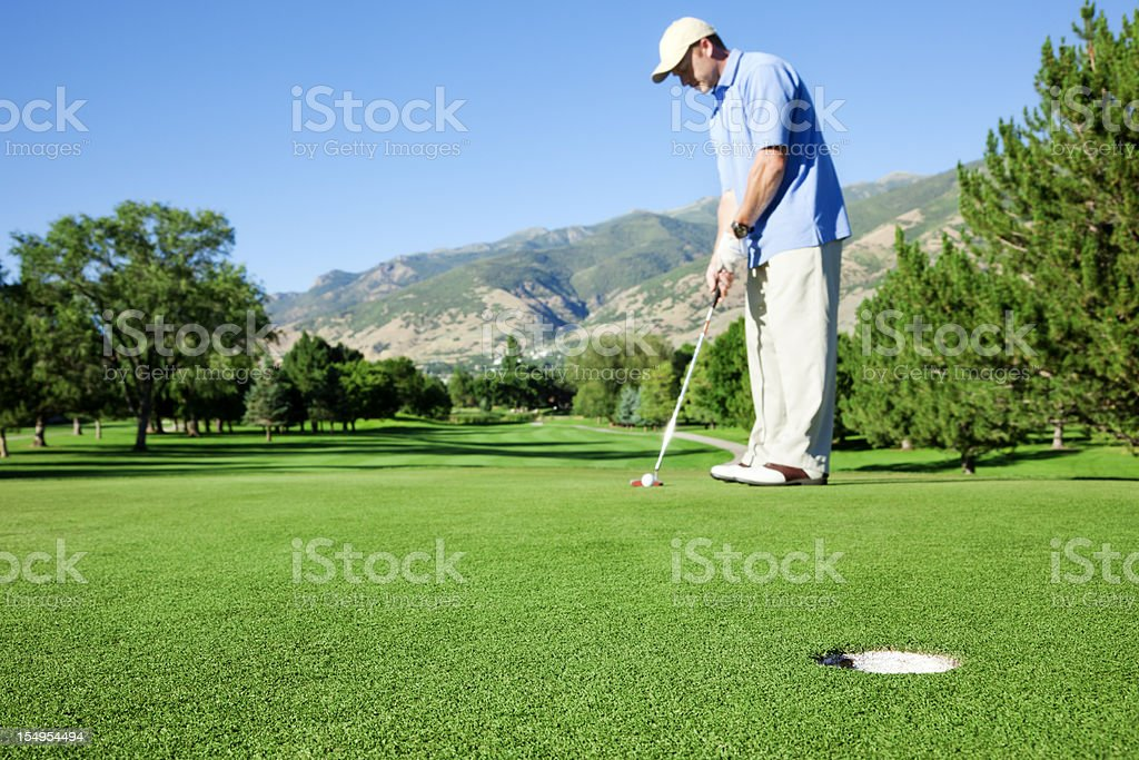 Golfer Lining Up to Putt royalty-free stock photo