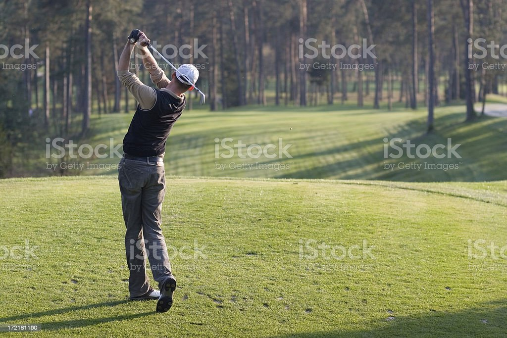 Golfer looking at his ball after the shot royalty-free stock photo