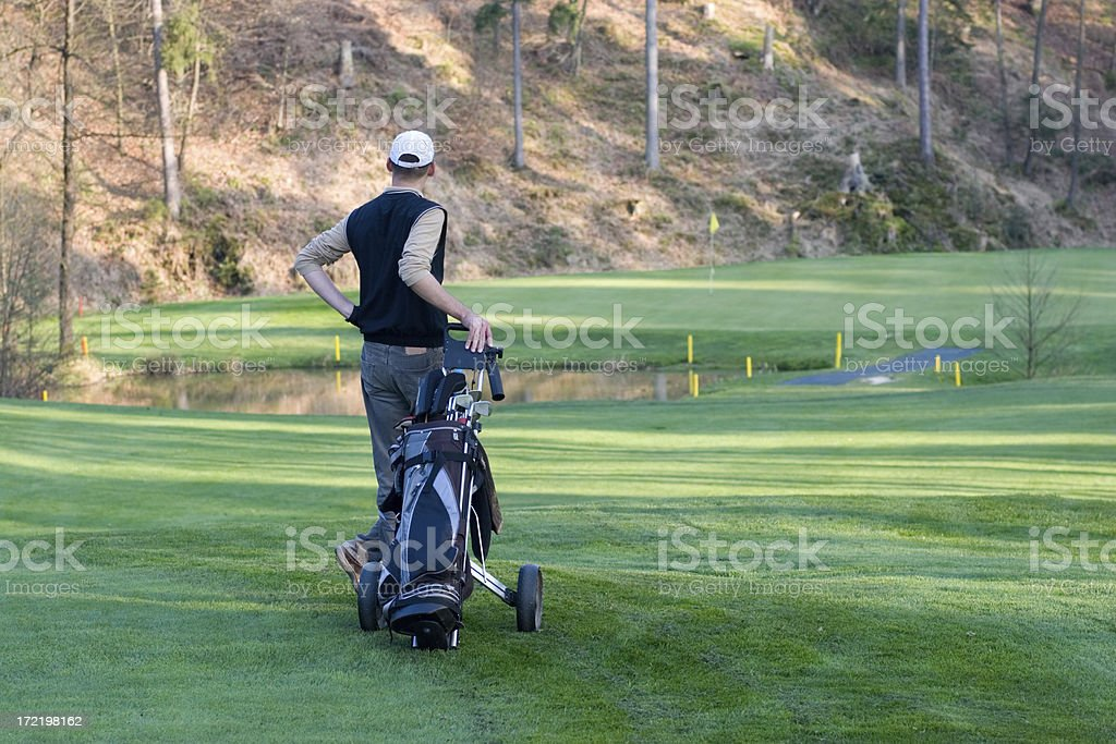 Golfer looking at the green royalty-free stock photo