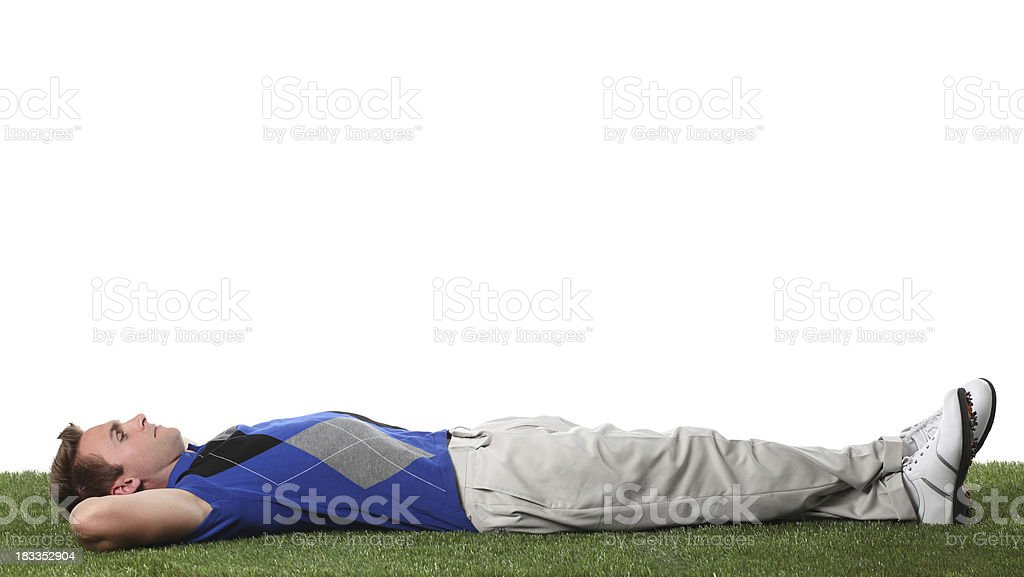 Golfer lying on grass in a golf course stock photo