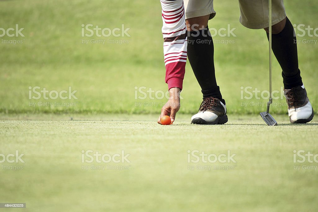 golfer mark his position ball stock photo