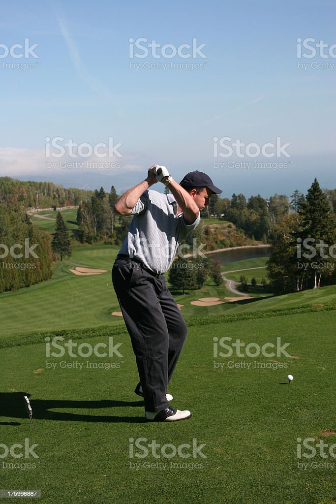 Golfer on a green royalty-free stock photo