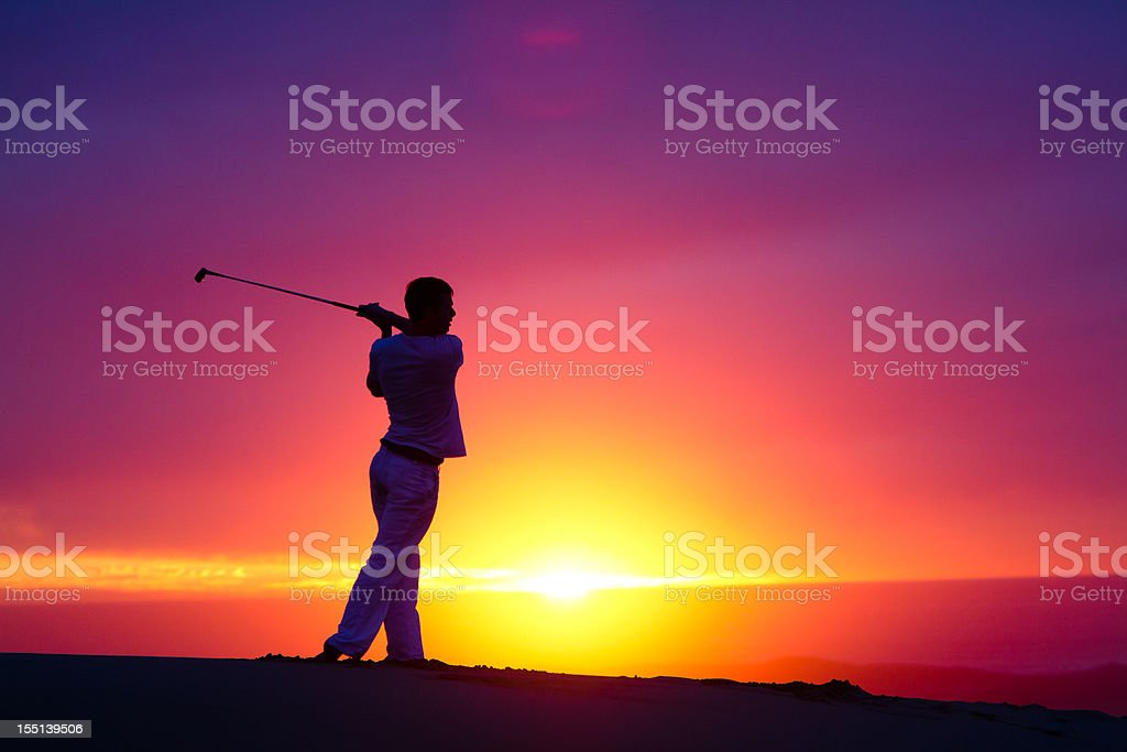 Golfer on a hill overlooking the pacific ocean in California royalty-free stock photo