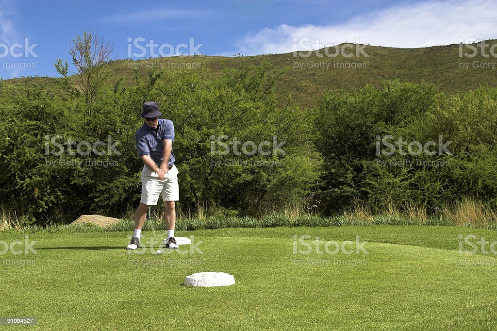 Golfer on the tee box. royalty-free stock photo