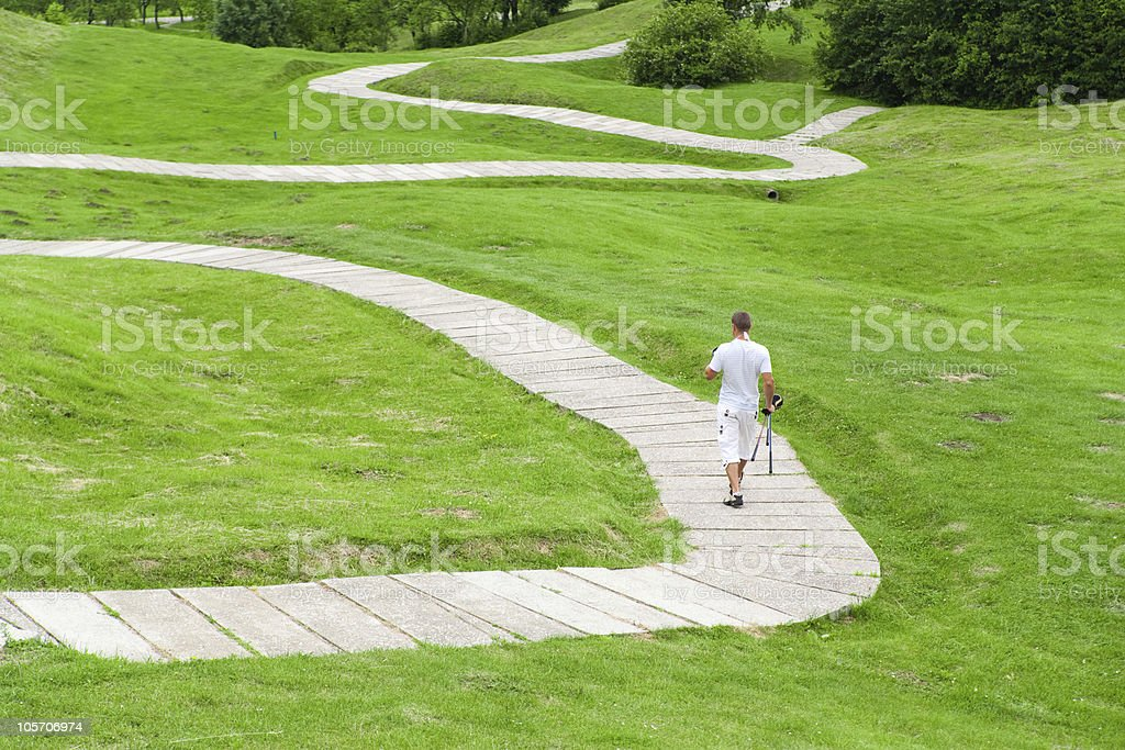 Golfer on walkway royalty-free stock photo