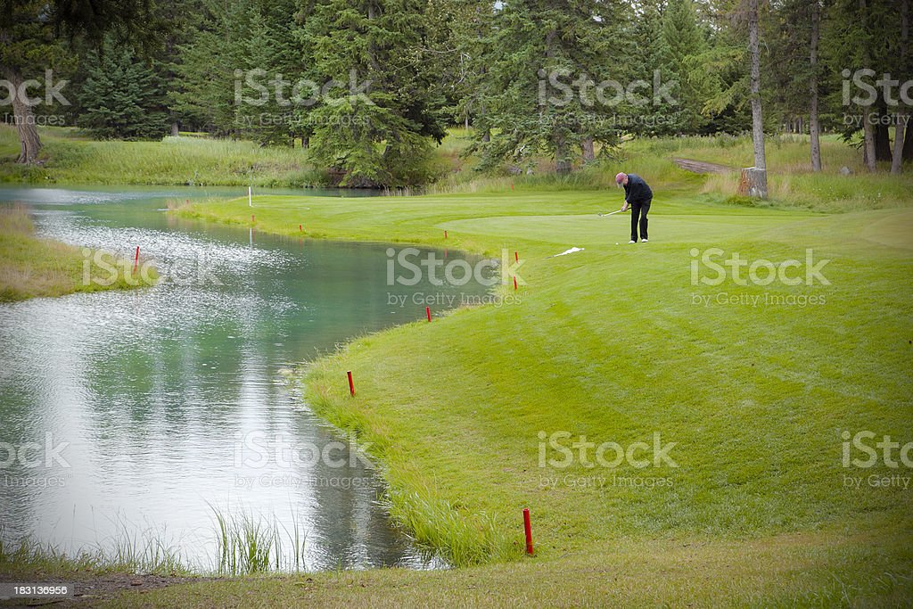 Golfer Playing a Chip Shot stock photo