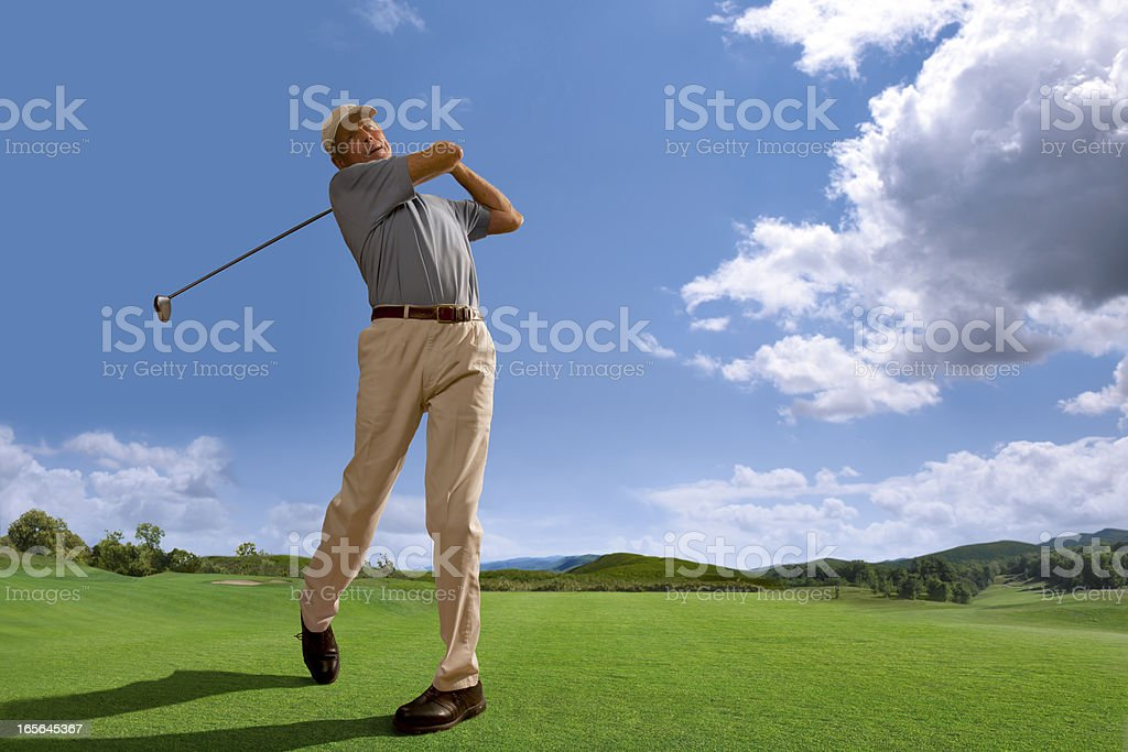 Golfer Playing on Course in Bright Daylight royalty-free stock photo