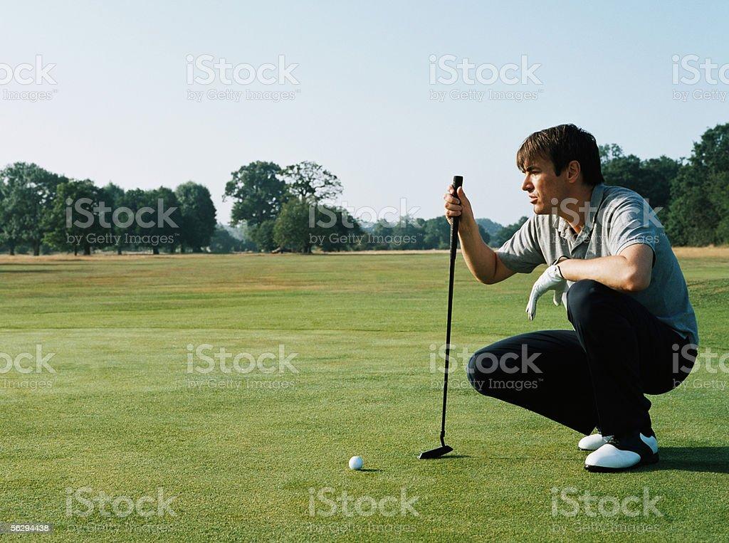 Golfer preparing to take a shot stock photo