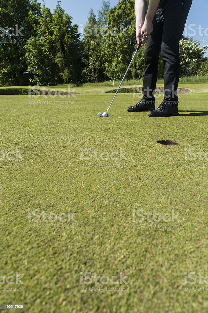 Golfer putting on a green stock photo