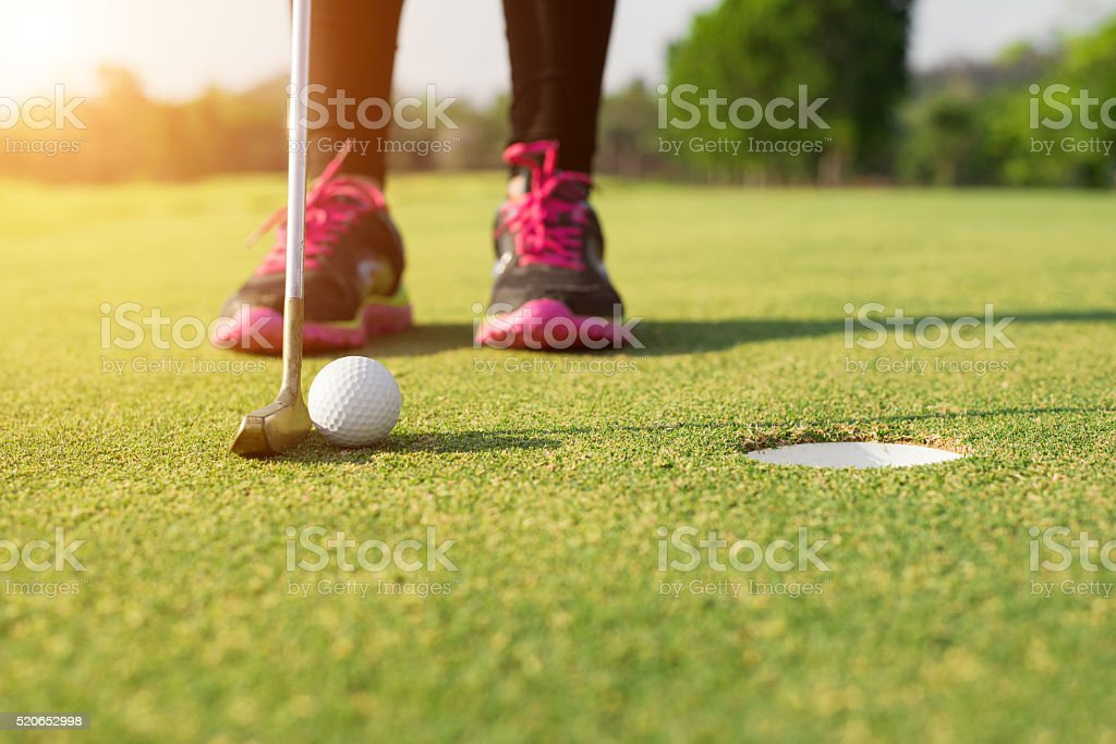 Golfer putting on green for birdie while on vacation stock photo