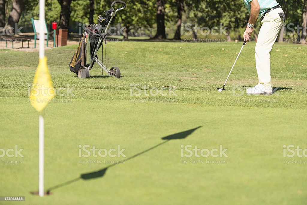 Golfer putting royalty-free stock photo