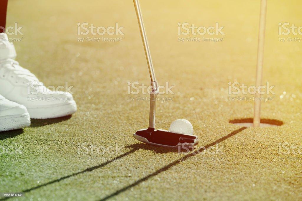 Golfer ready to strike stock photo