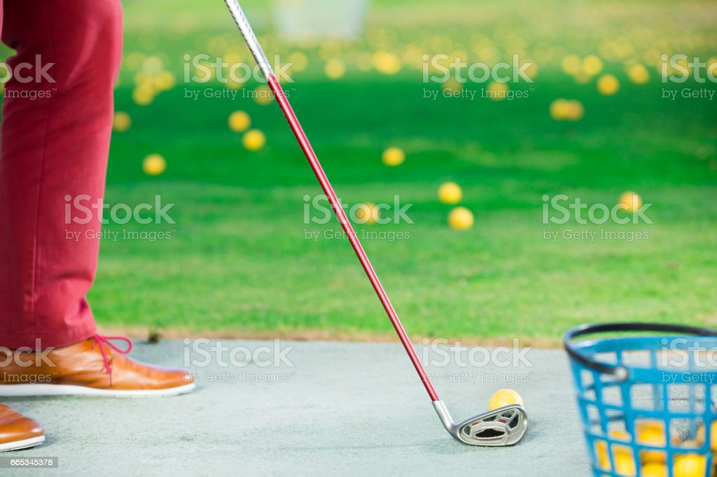 Golfer ready to strike the ball with a club stock photo