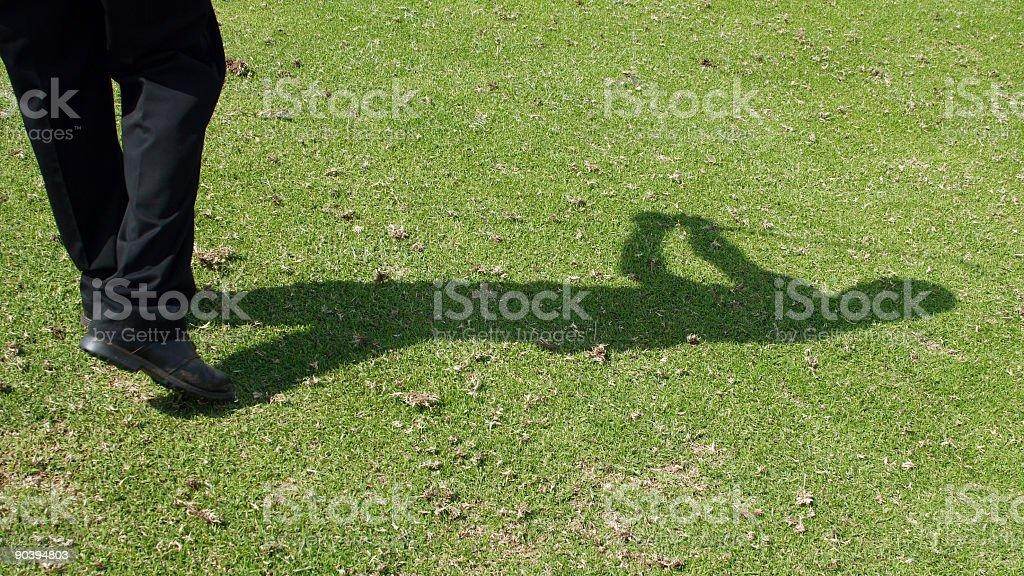 Golfer shadow stock photo