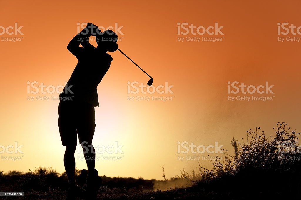 Golfer Silhouette at Sunset royalty-free stock photo