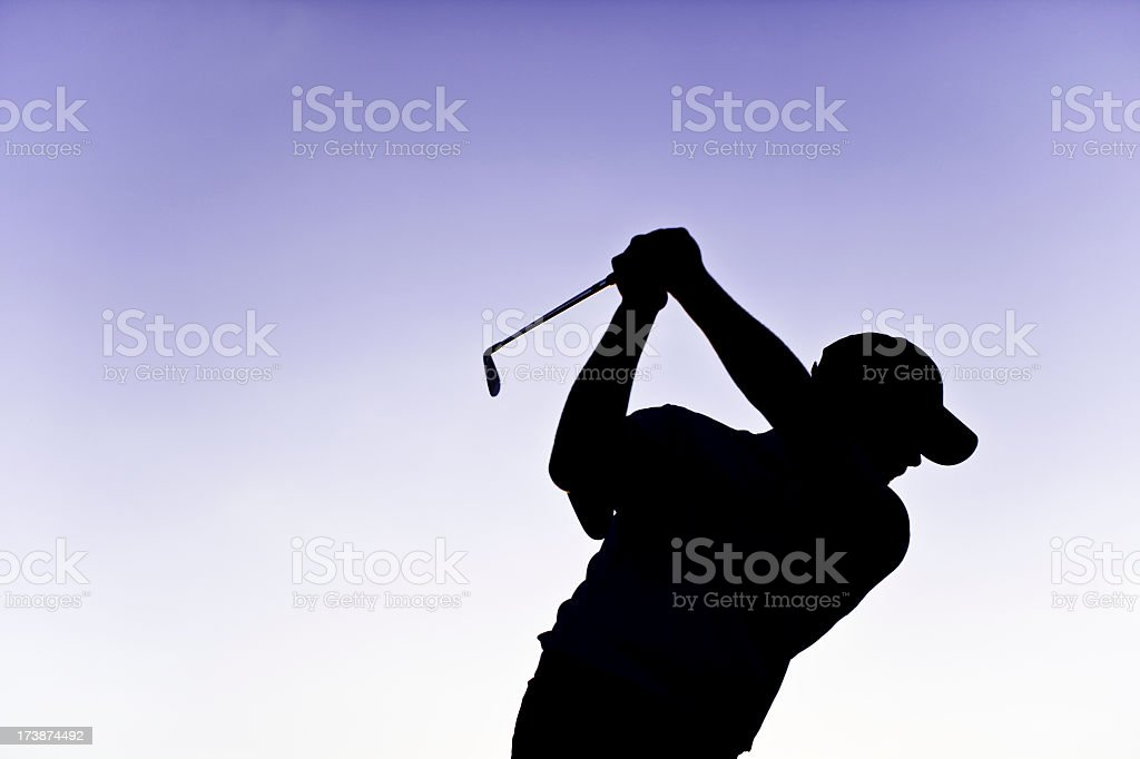 Golfer Silhouette at Top of Swing royalty-free stock photo