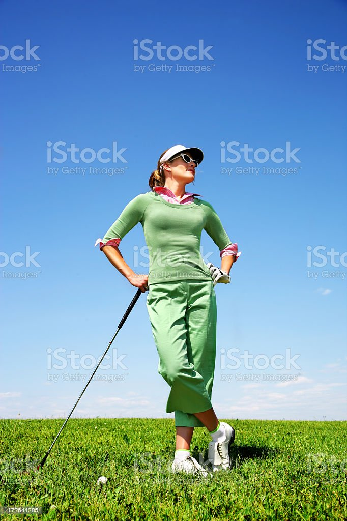 Golfer standing and waiting royalty-free stock photo