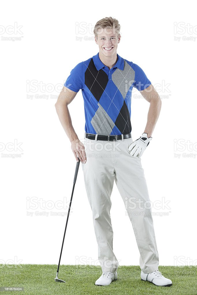 Golfer standing in golf course royalty-free stock photo