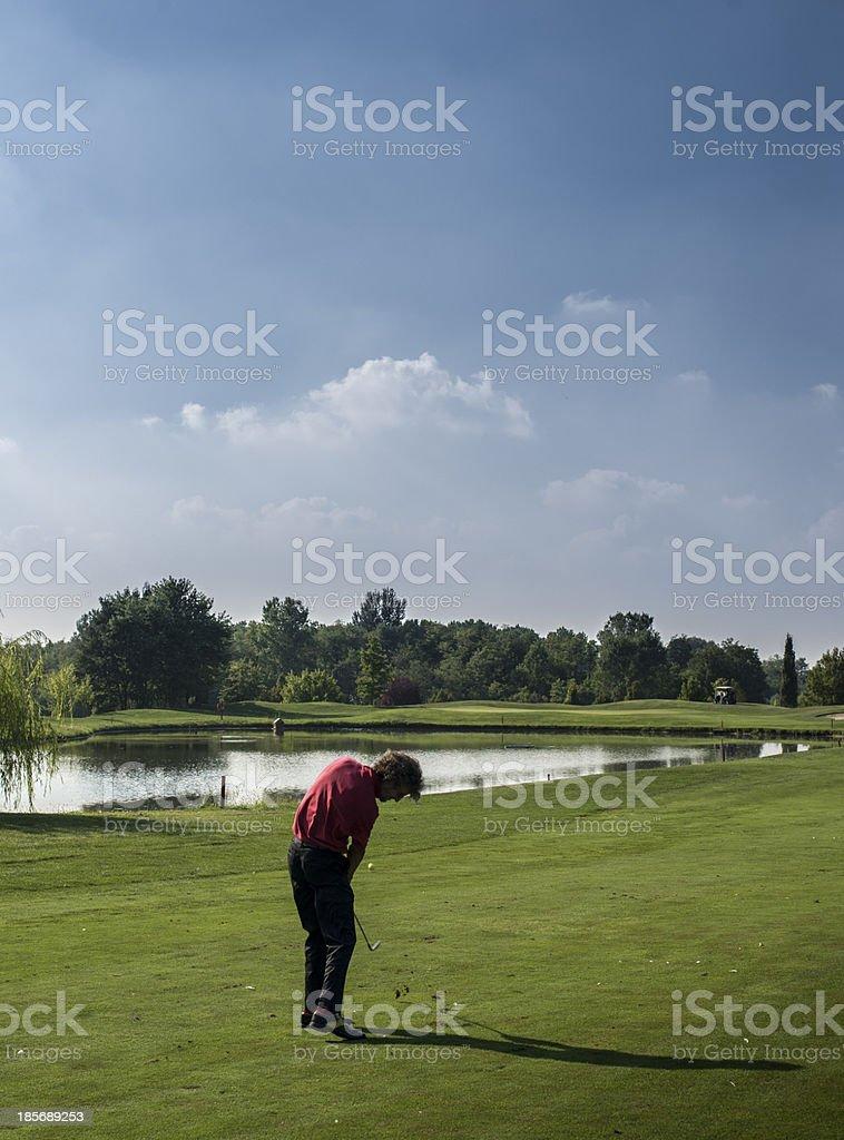 golfer striking the ball royalty-free stock photo