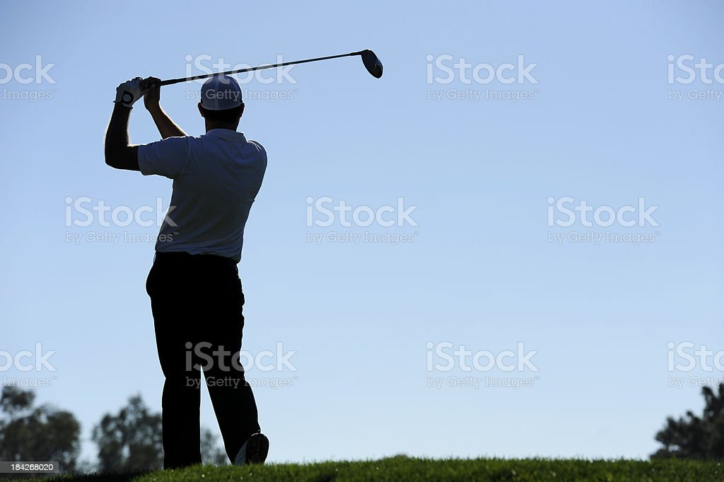 Golfer swing stock photo