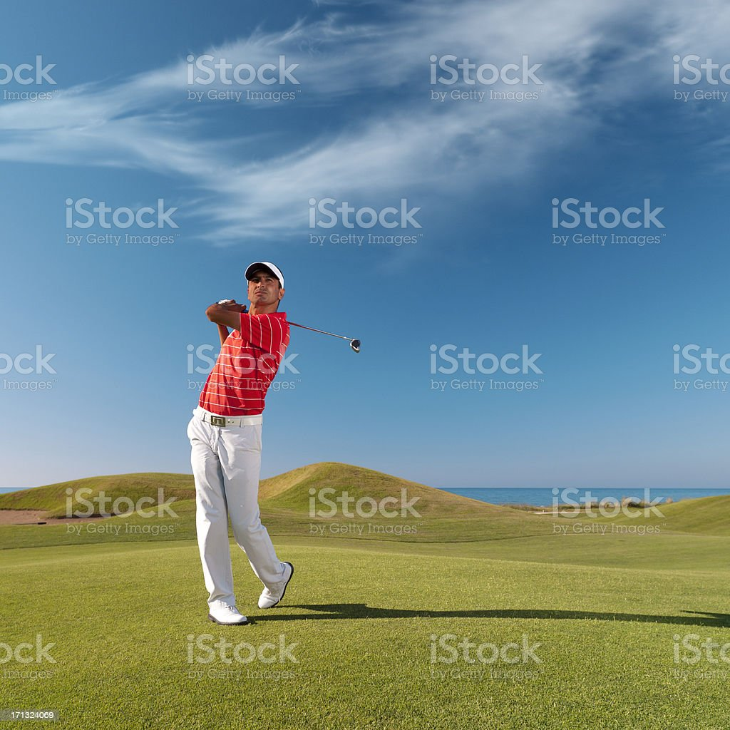 Golfer swinging royalty-free stock photo