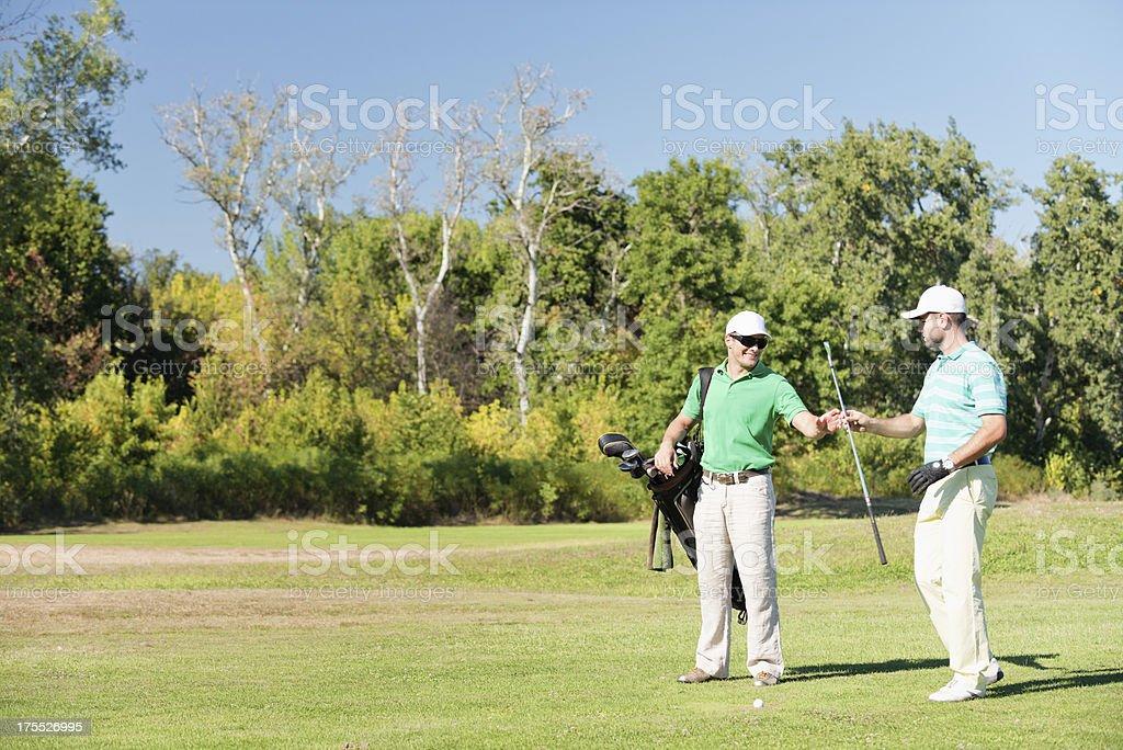 Golfer takes a club stock photo