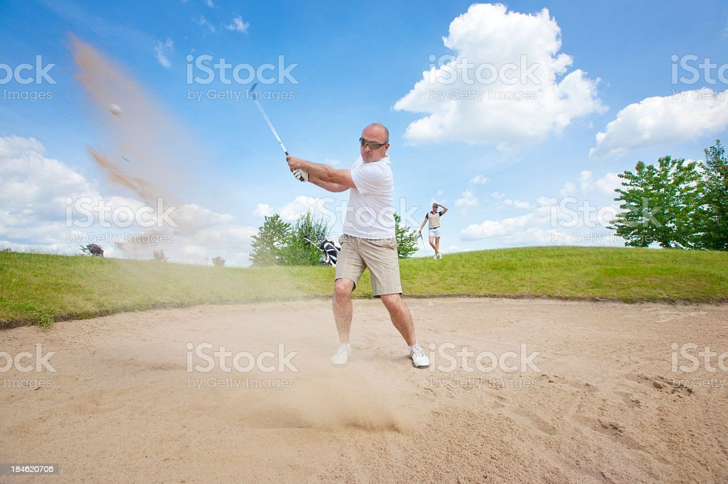 Golfer taking a good golf swing royalty-free stock photo