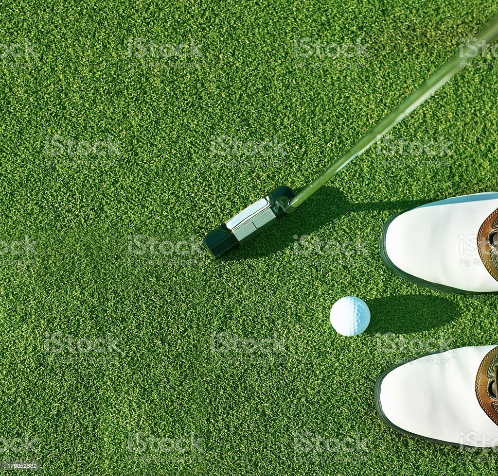 Golfer taking a shot of the ball royalty-free stock photo