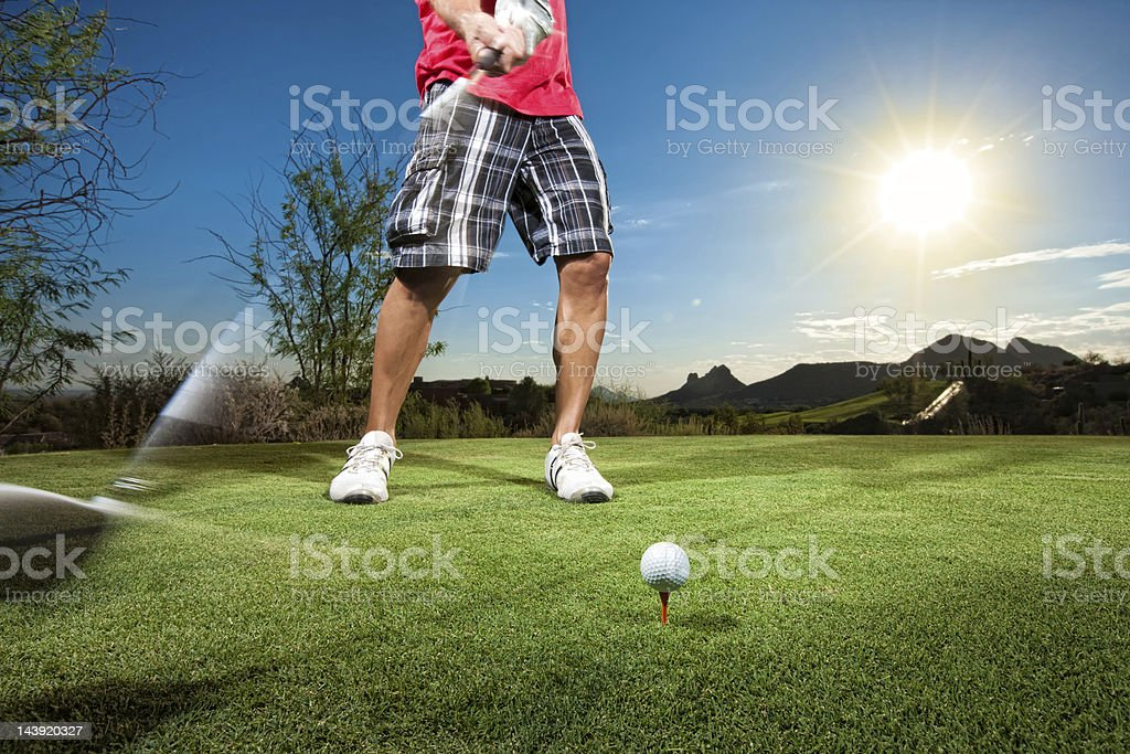 Golfer Teeing Off at Sunset royalty-free stock photo