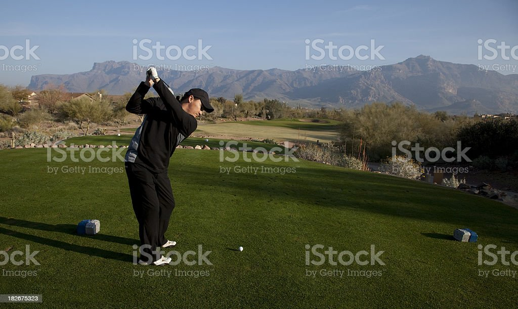 Golfer Teeing Off in Arizona royalty-free stock photo