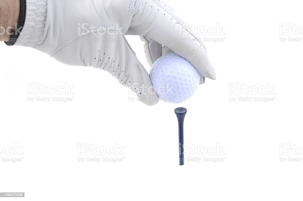 Golfer Teeing Up a Golf Ball royalty-free stock photo