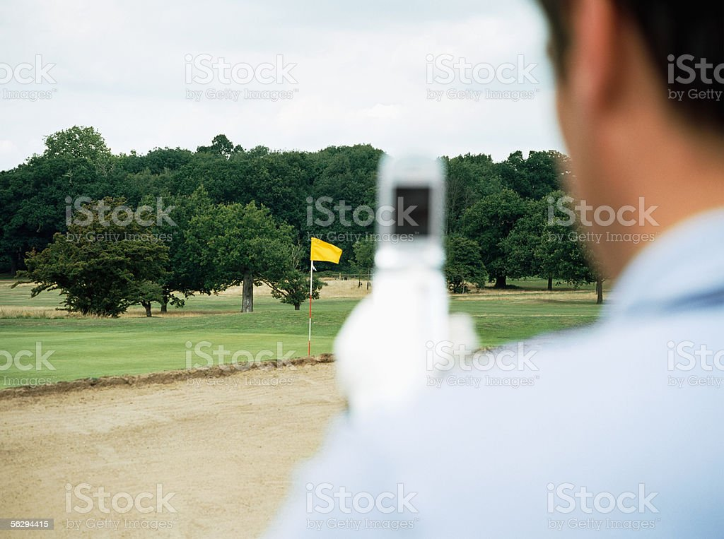 Golfer using camera phone royalty-free stock photo