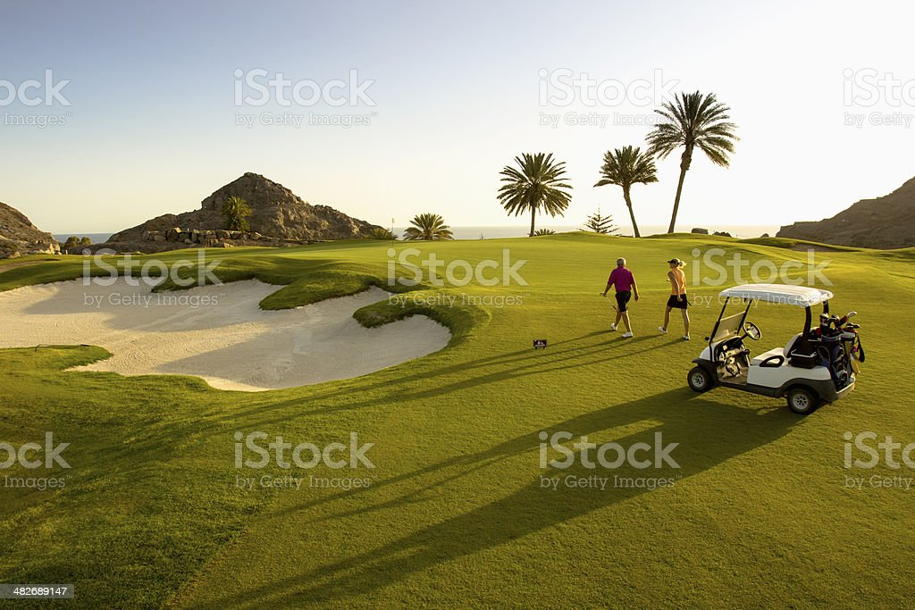 Golfers at the putting green stock photo