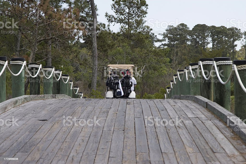 Golfers Crossing a Bridge in Southern Georgia stock photo