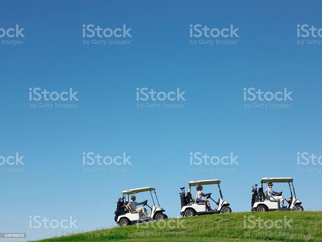 Golfers Driving Carts stock photo