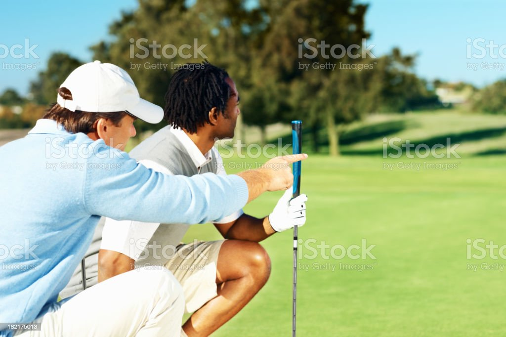 Golfers during a discussion on course stock photo