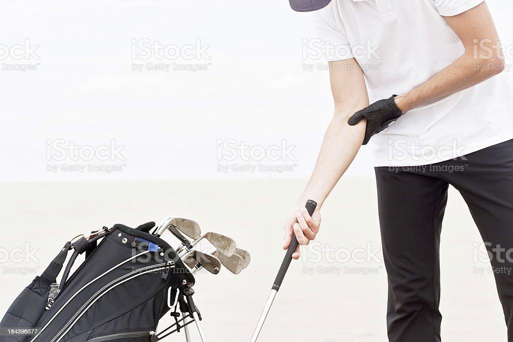 Golfer`s elbow stock photo