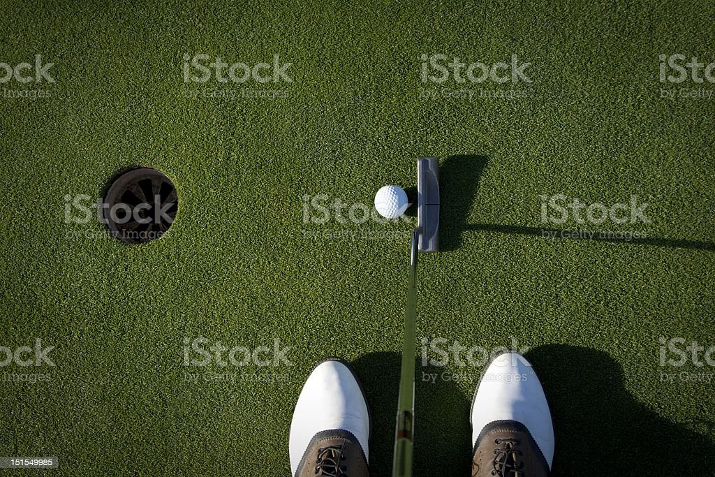 Golfer's eye view of a putt stock photo